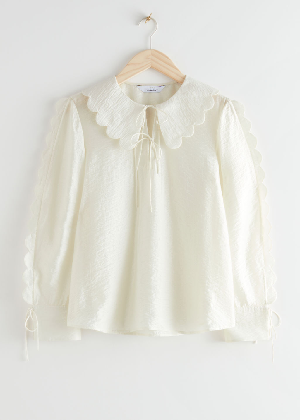 StillLife Front Image of Stories Wide Scallop Blouse in White