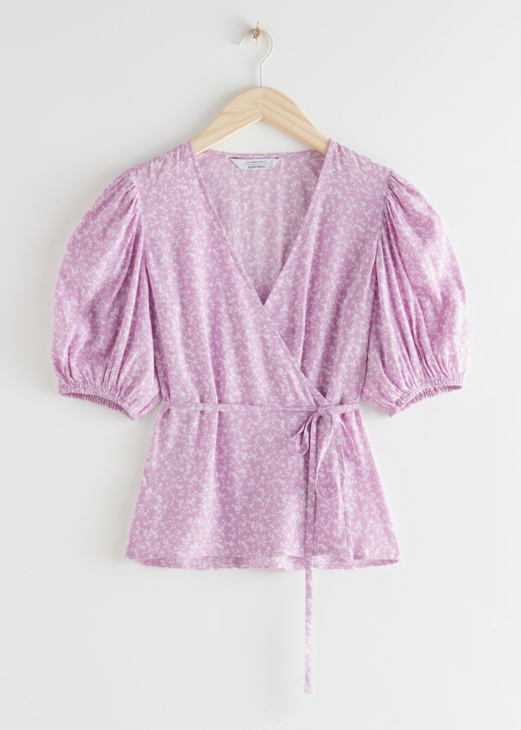 StillLife Front Image of Stories Printed Puff Sleeve Wrap Top in Purple