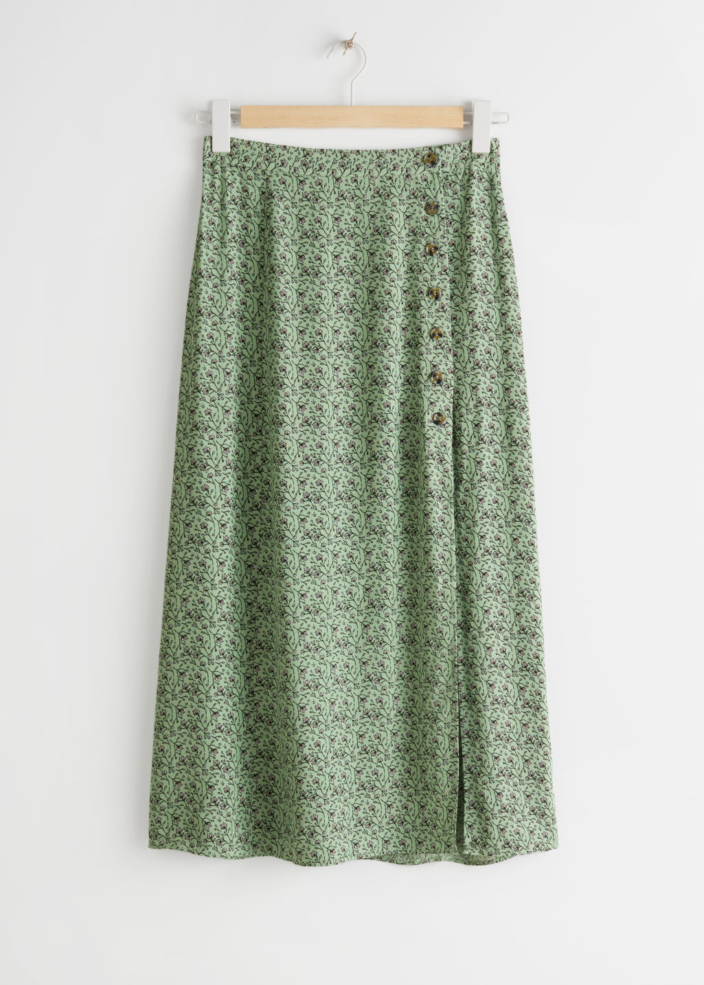 StillLife Front Image of Stories Asymmetrical Button Midi Skirt in Green