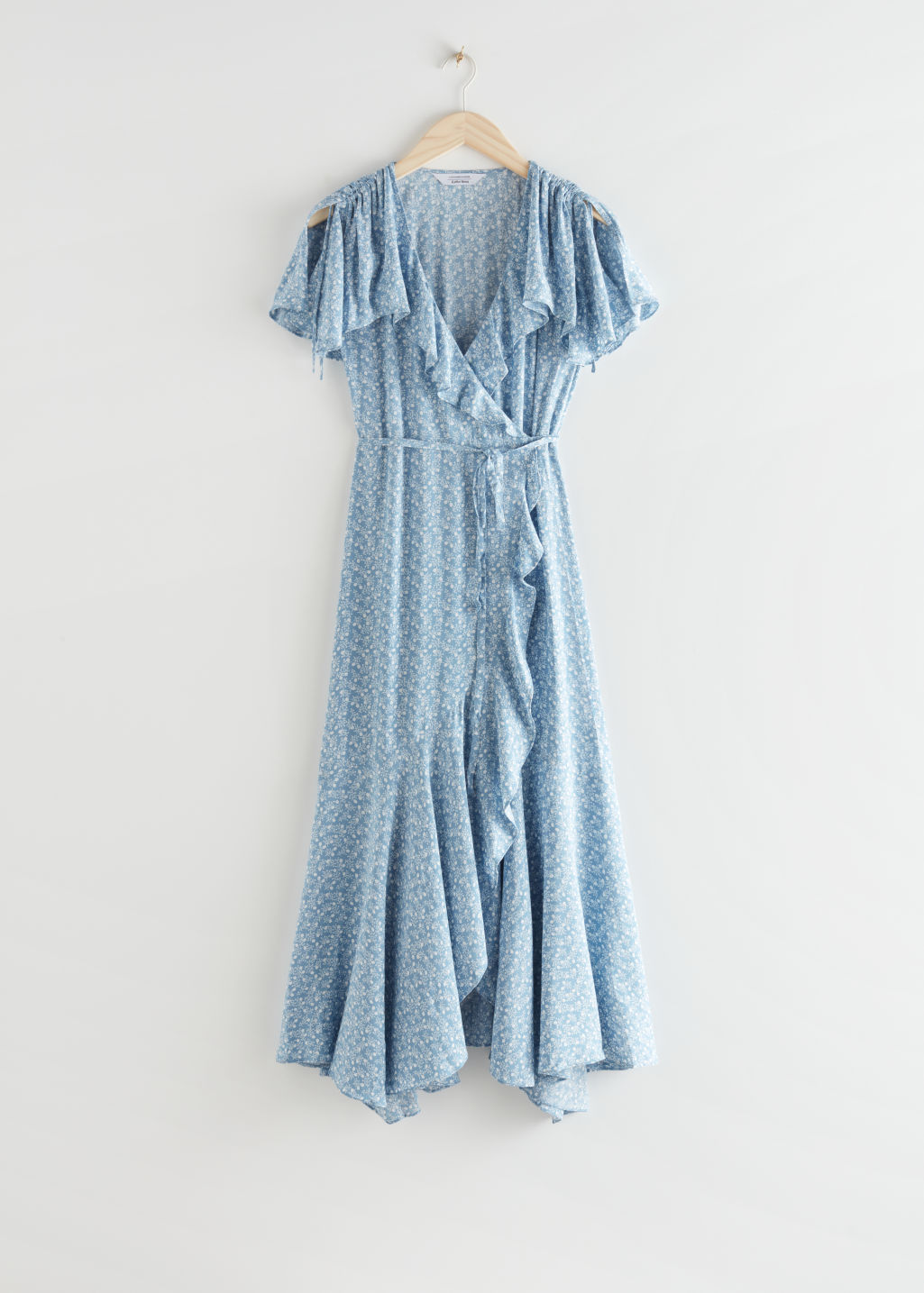 StillLife Front Image of Stories Asymmetric Wrap Midi Dress in Blue
