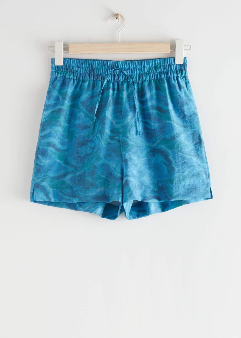 StillLife Front Image of Stories Relaxed Drawstring Shorts in Blue
