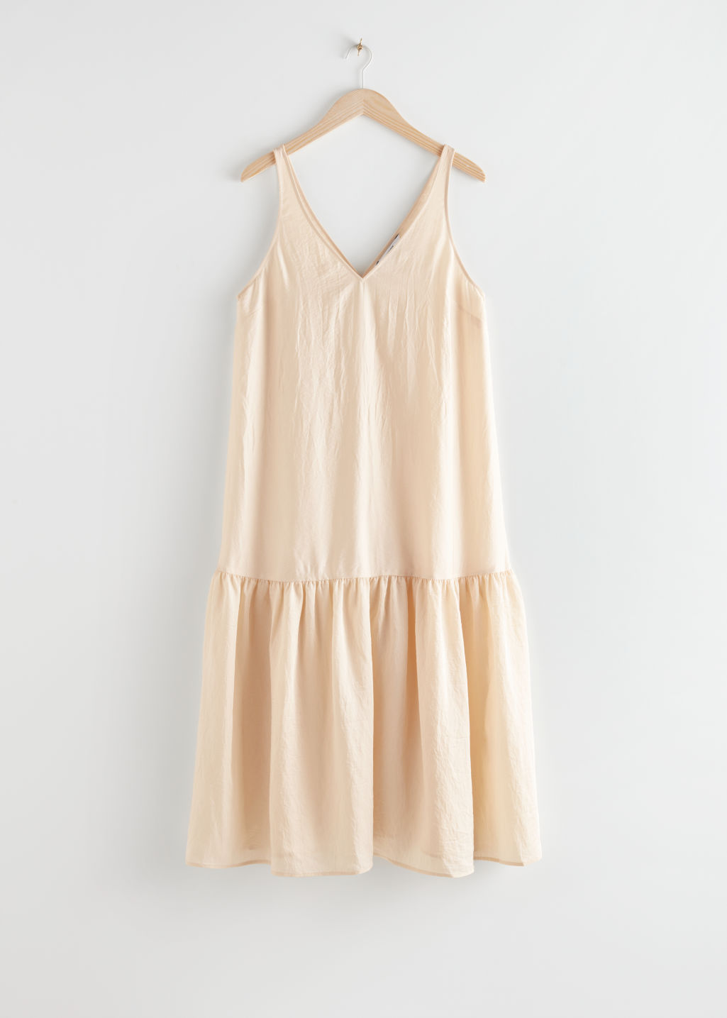 StillLife Front Image of Stories Voluminous V-Neck Midi Dress in Beige
