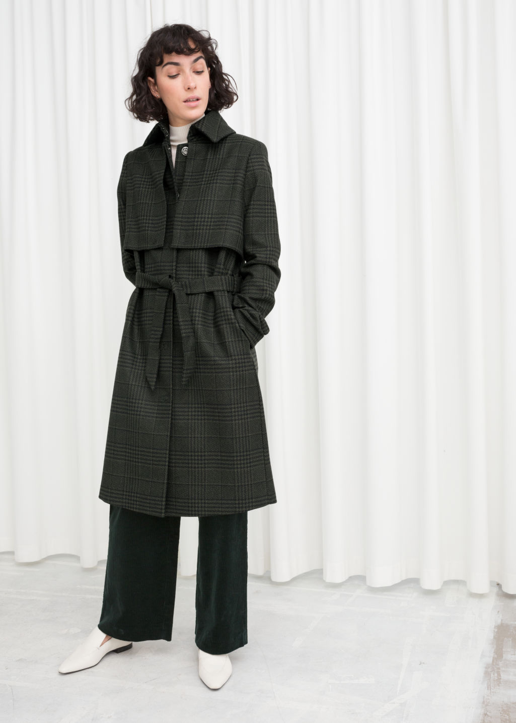 Model front image of Stories wool trenchcoat in green
