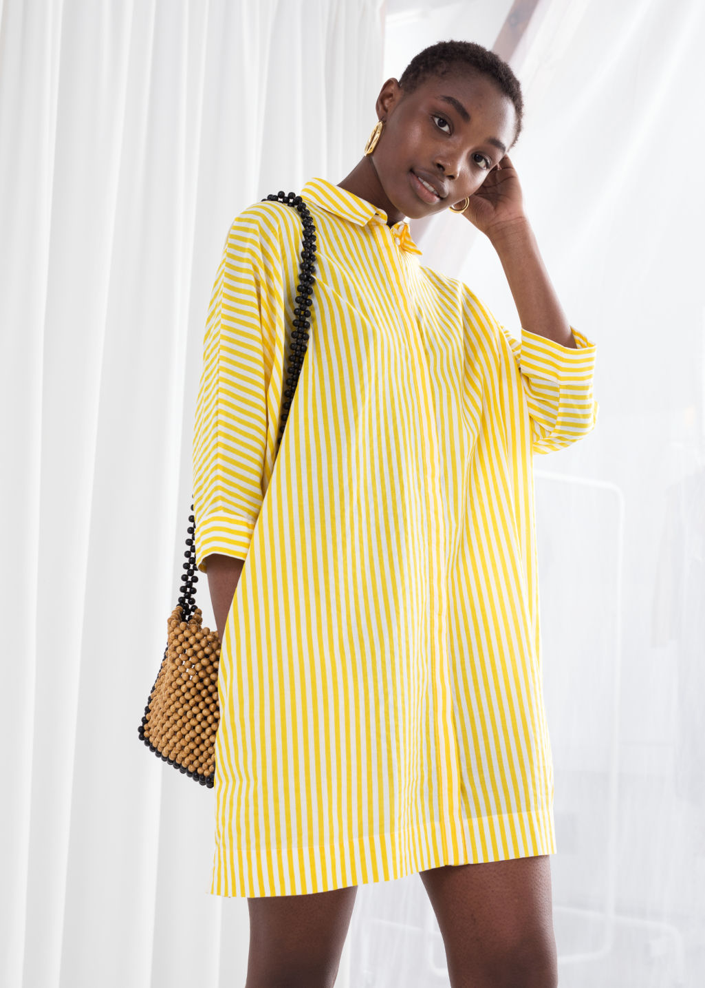 Model front image of Stories cotton shirt dress in yellow
