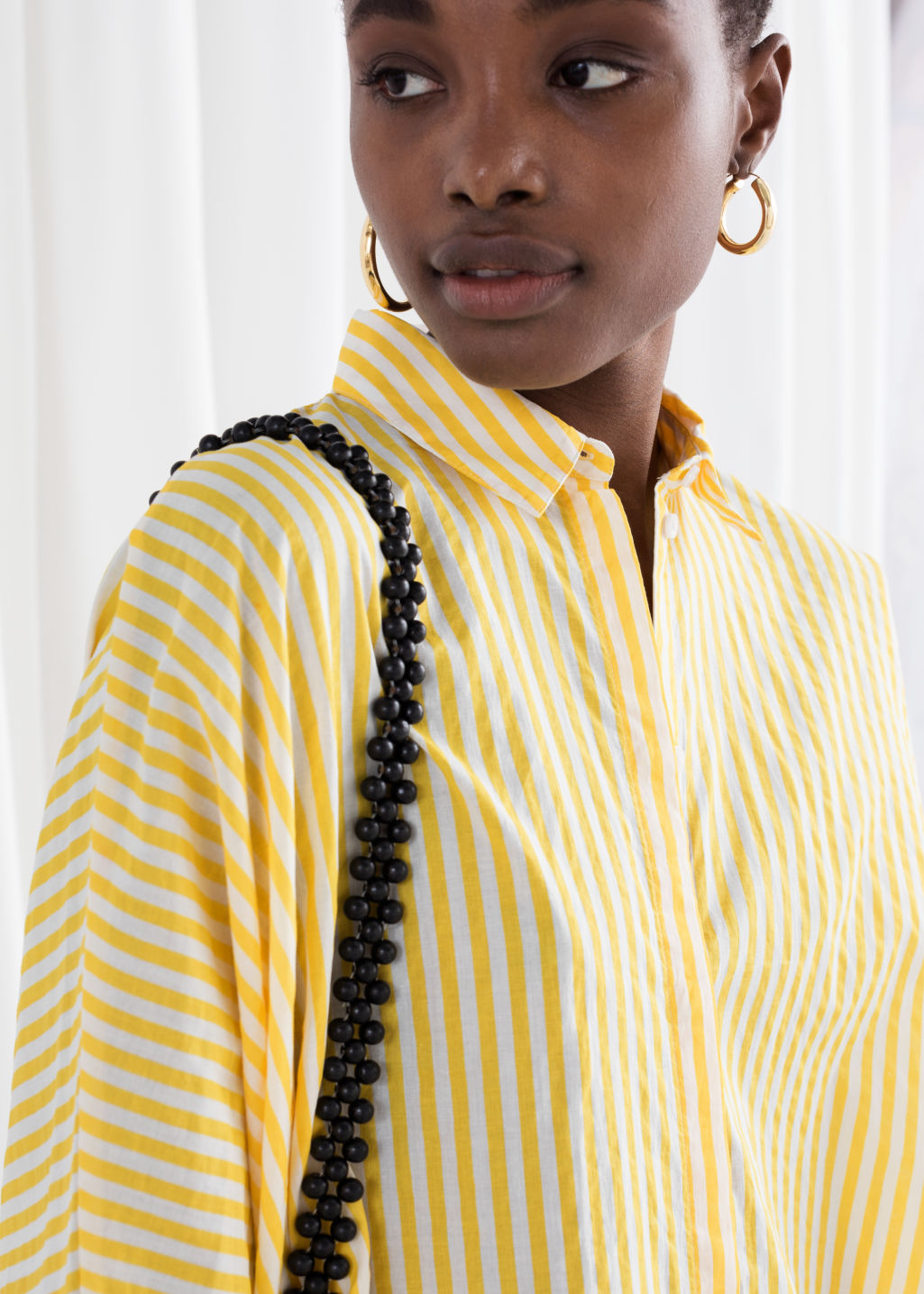 Model back image of Stories cotton shirt dress in yellow