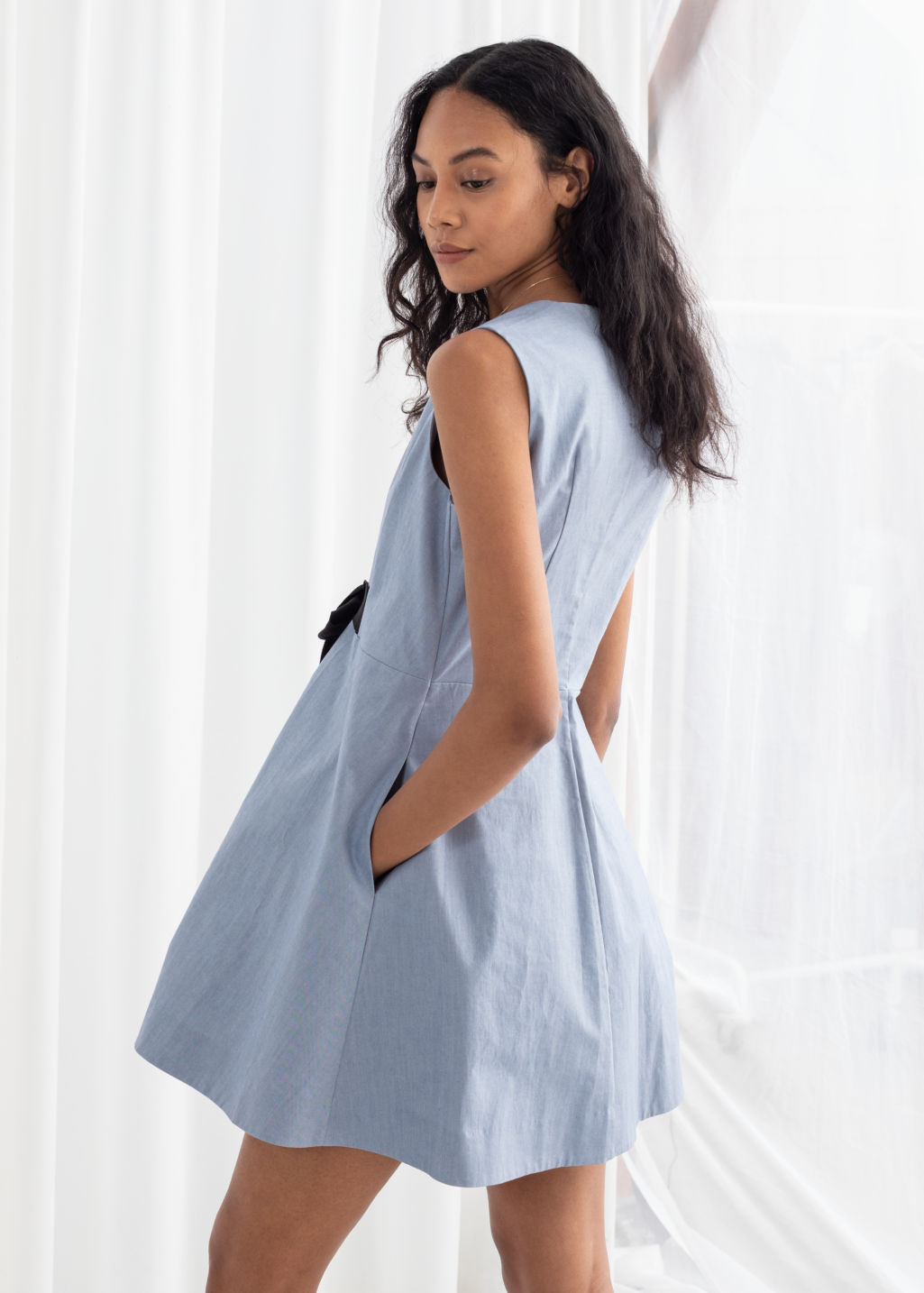 Model back image of Stories a-line cotton dress in blue