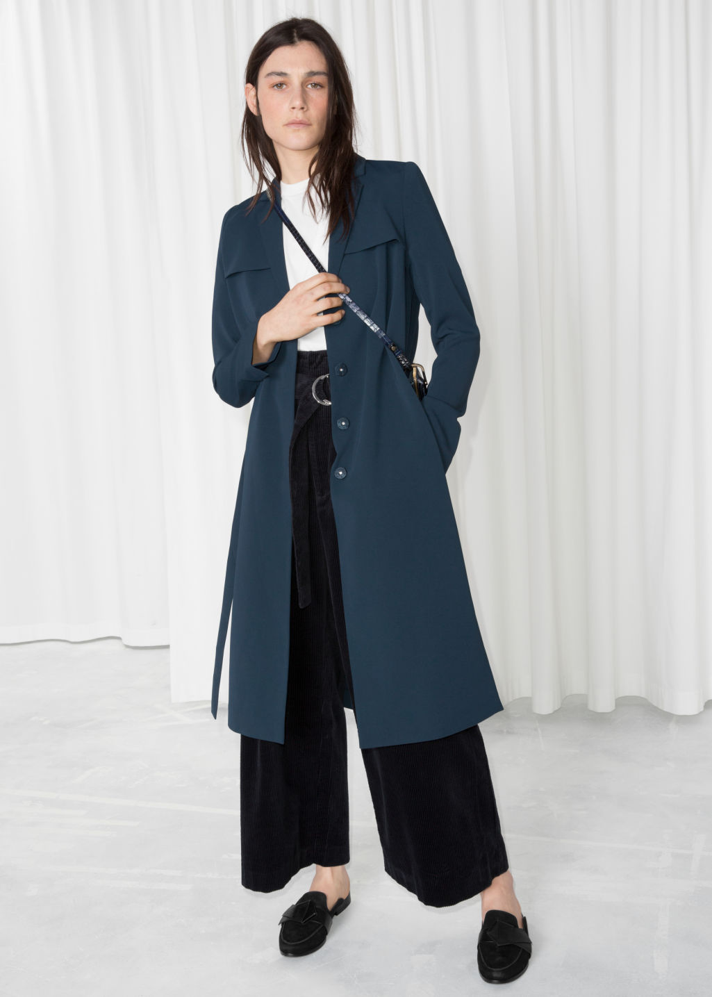 Model front image of Stories trench coat in blue