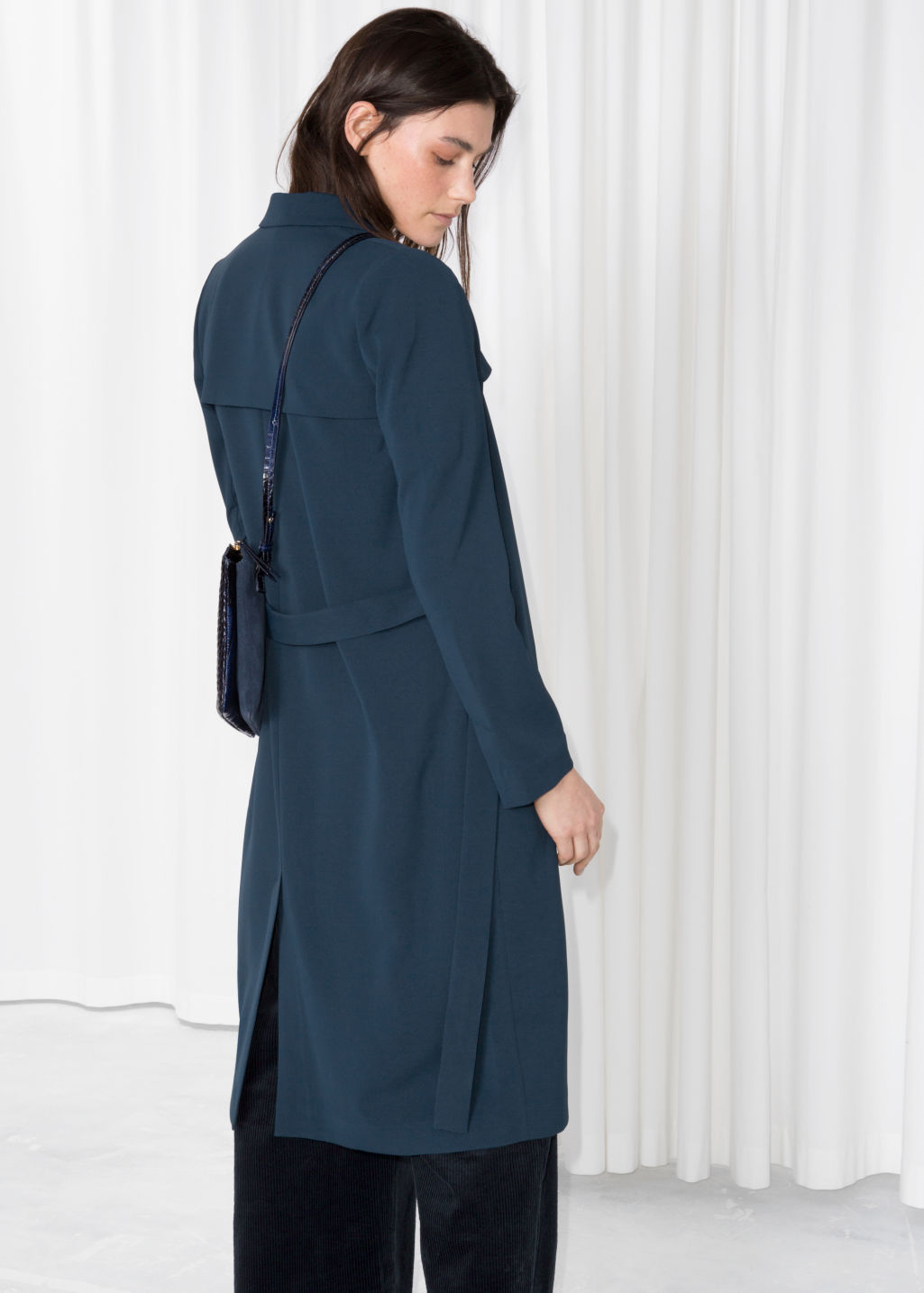 Model back image of Stories trench coat in blue