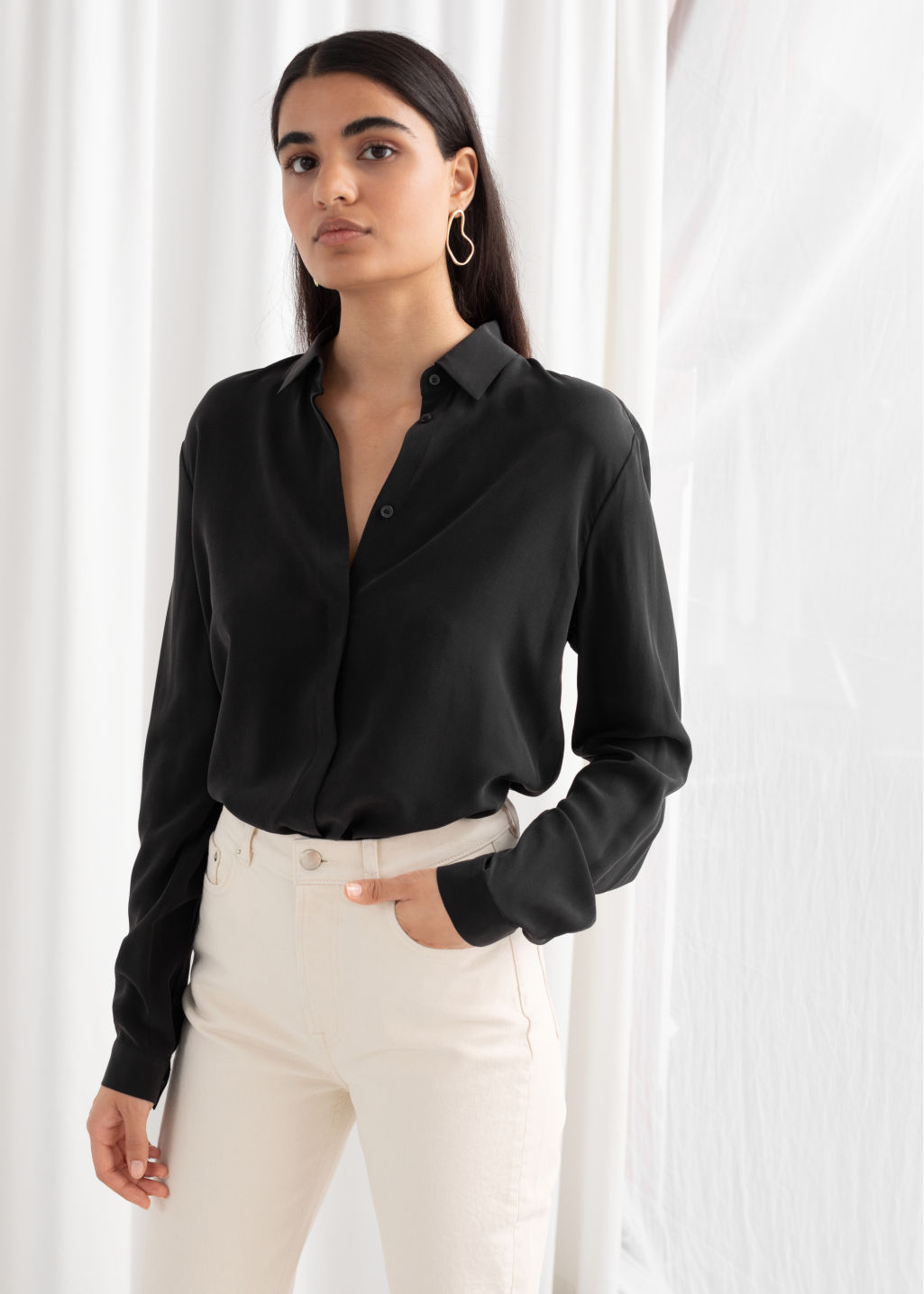 Model front image of Stories straight fit silk shirt in black