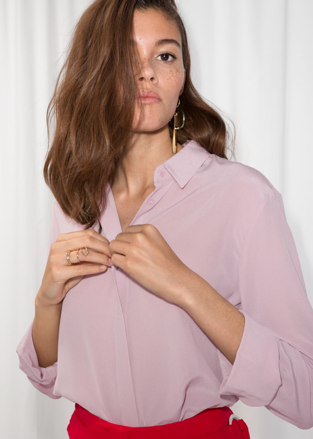 Model front image of Stories straight fit silk shirt in pink