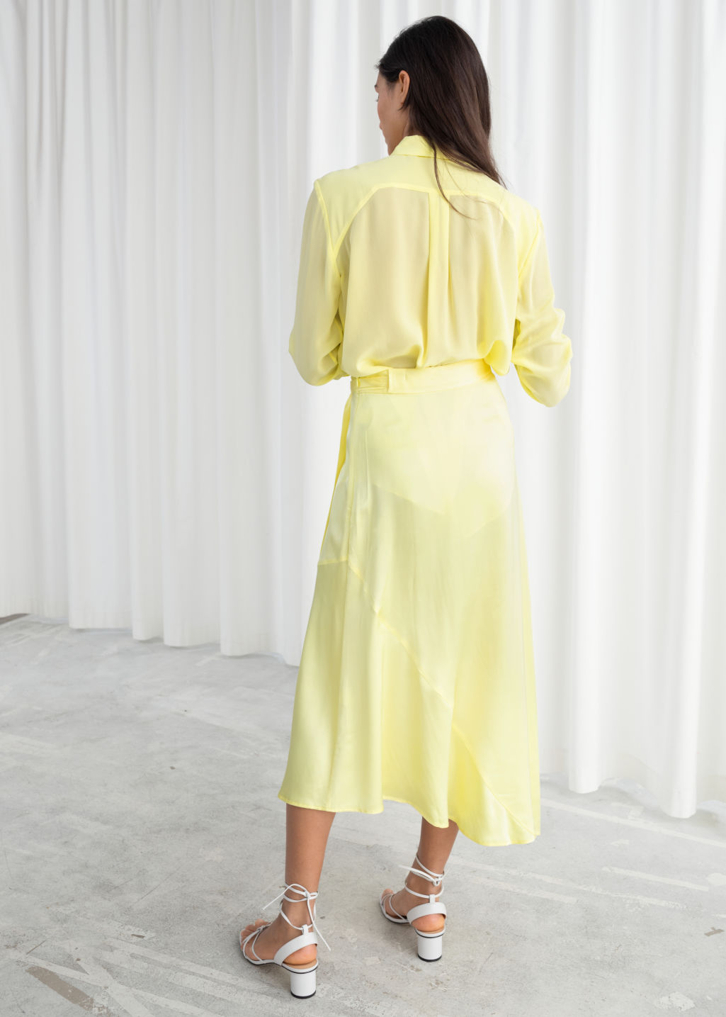 Model back image of Stories straight fit silk shirt in yellow
