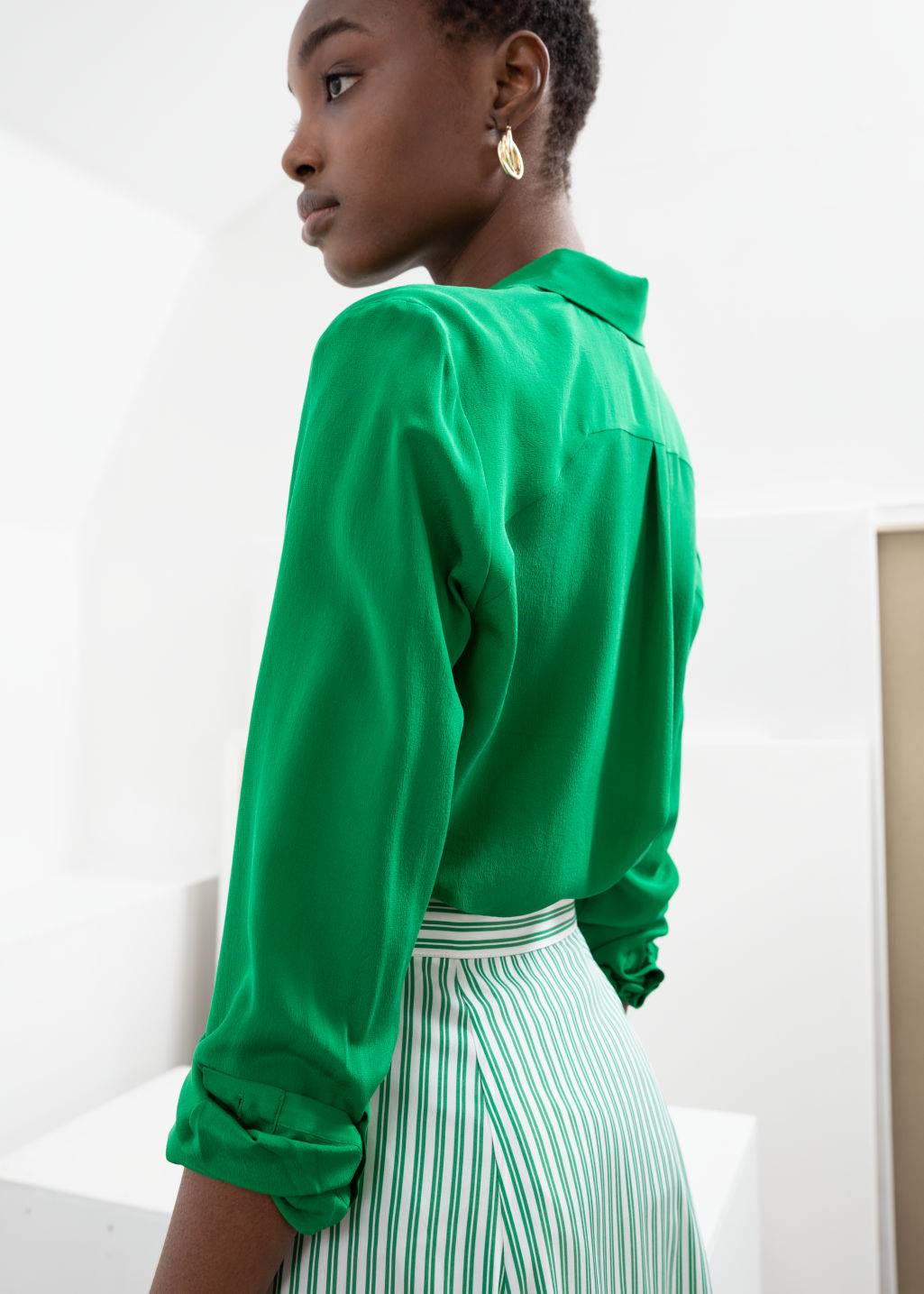 Model back image of Stories straight fit silk shirt in green