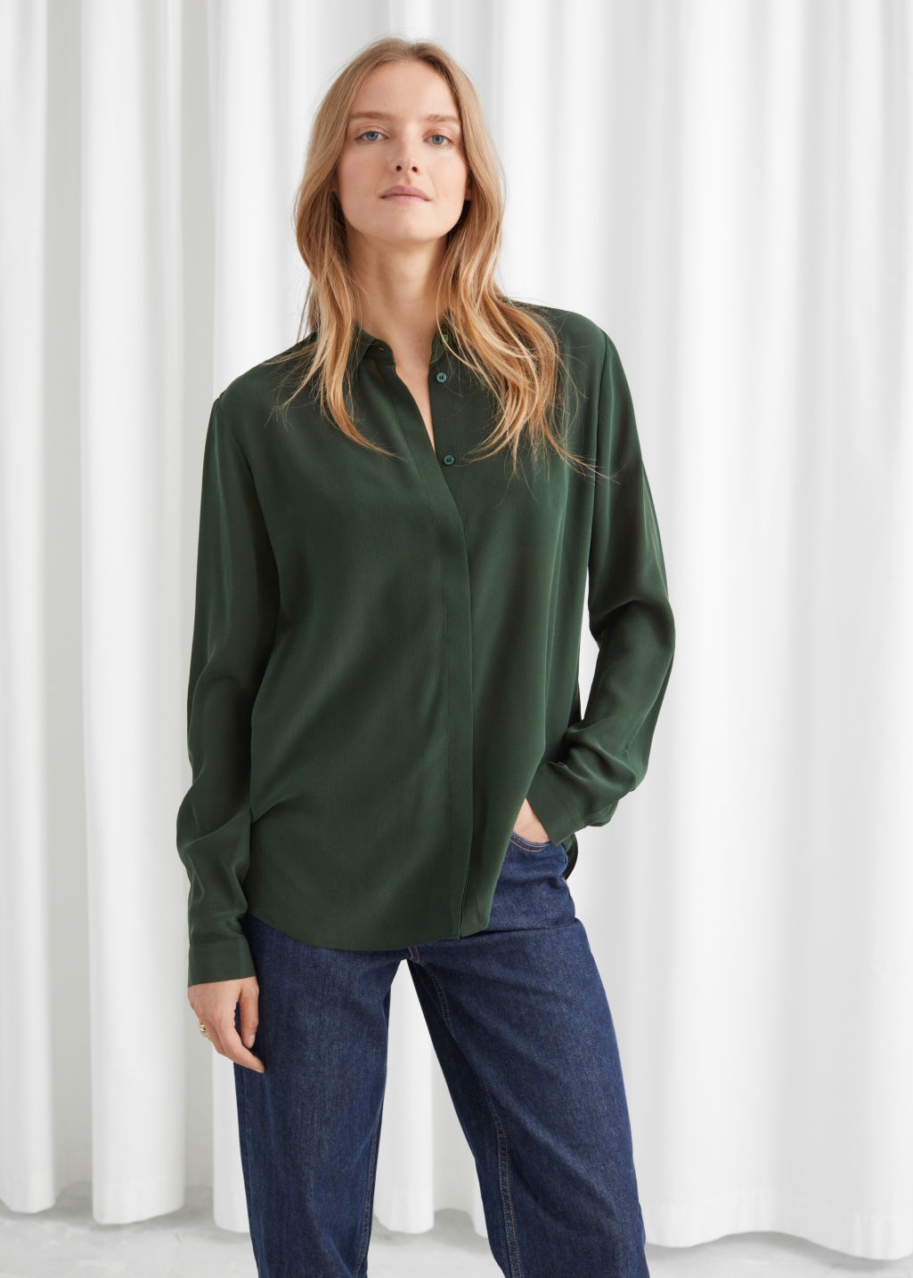 Model front image of Stories straight fit silk shirt in green