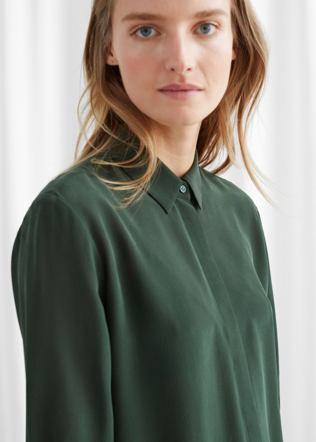 Model side image of Stories straight fit silk shirt in green