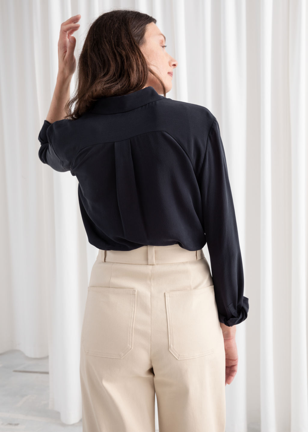 Model back image of Stories straight fit silk shirt in blue
