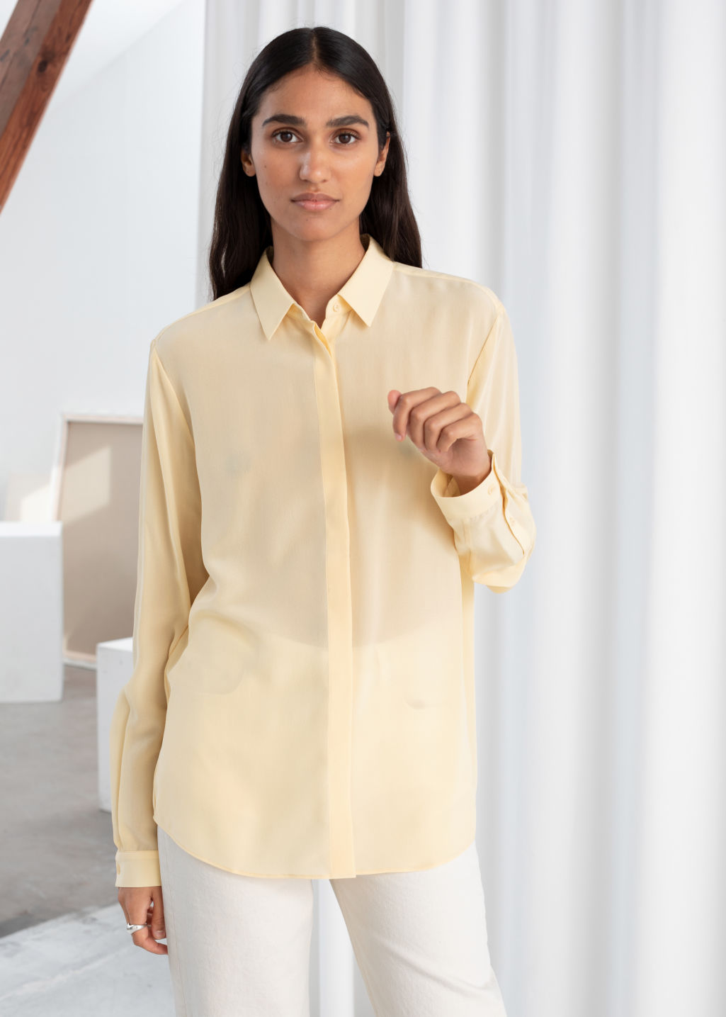 Model front image of Stories straight fit silk shirt in beige