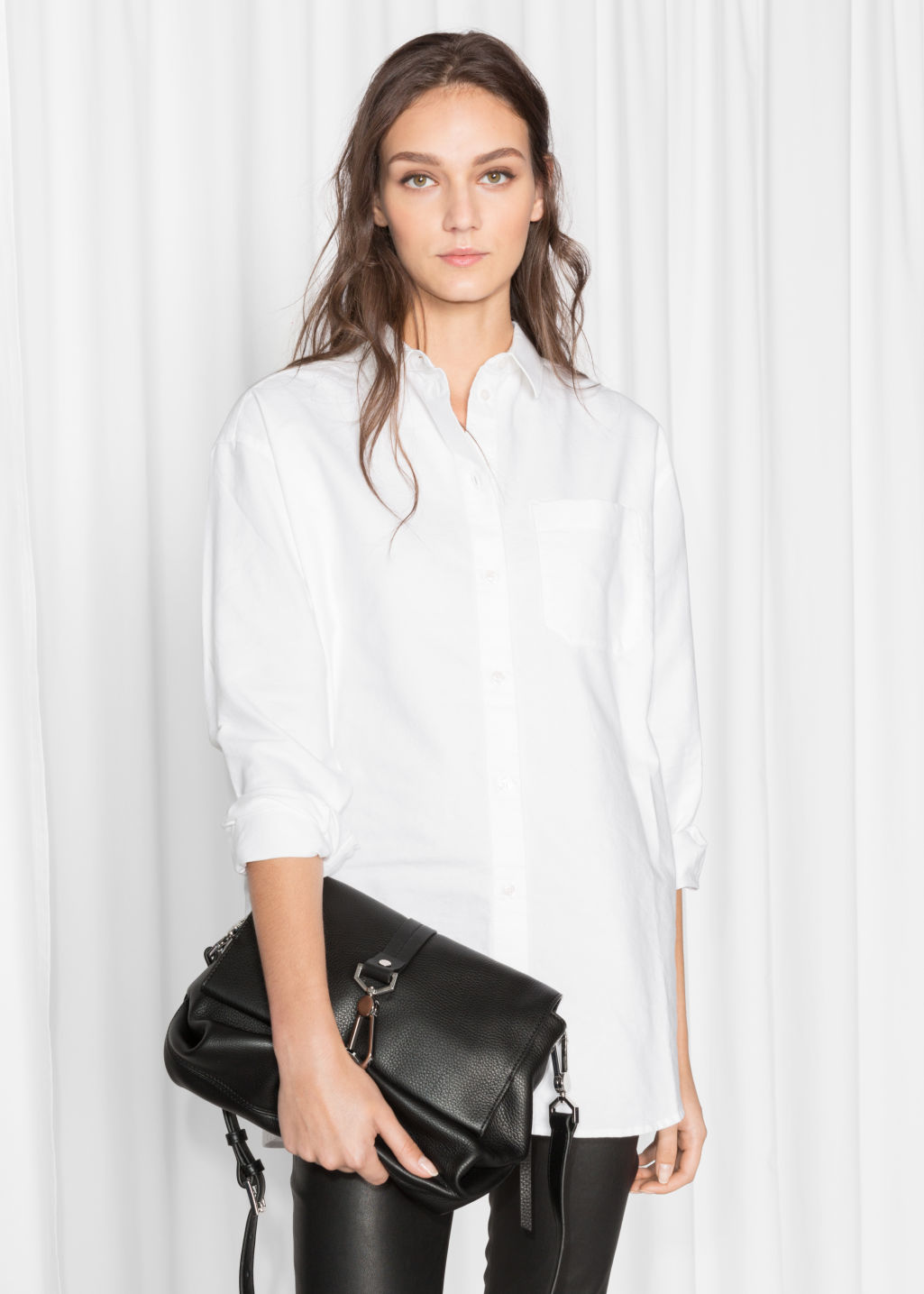 Model front image of Stories oversized shirt in white
