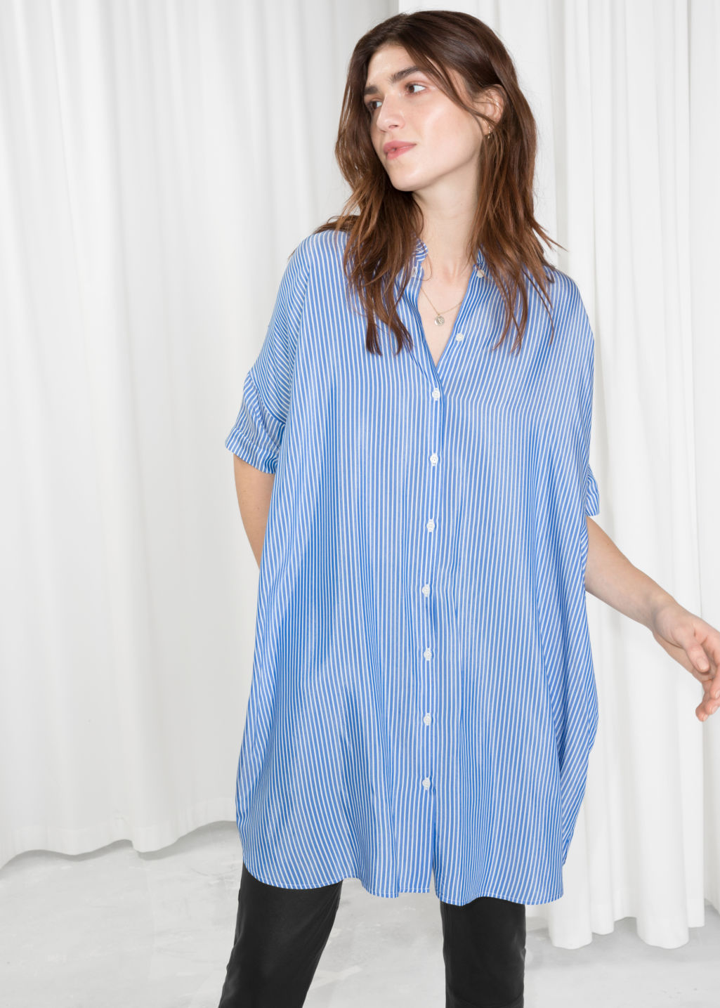 Model front image of Stories oversized shirt dress in blue