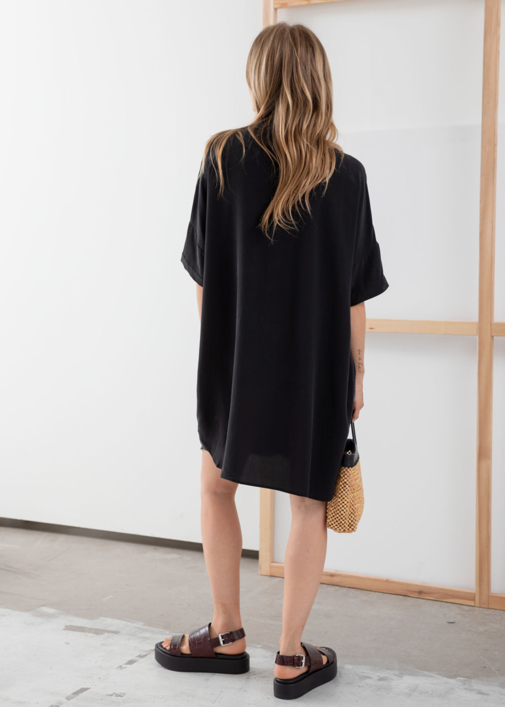 Model back image of Stories oversized shirt dress in black