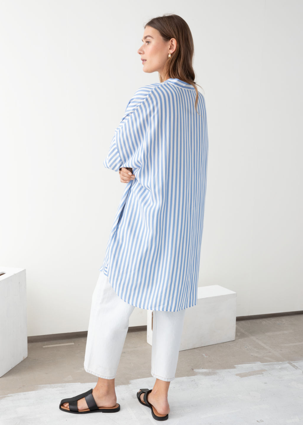 Model back image of Stories oversized shirt dress in blue