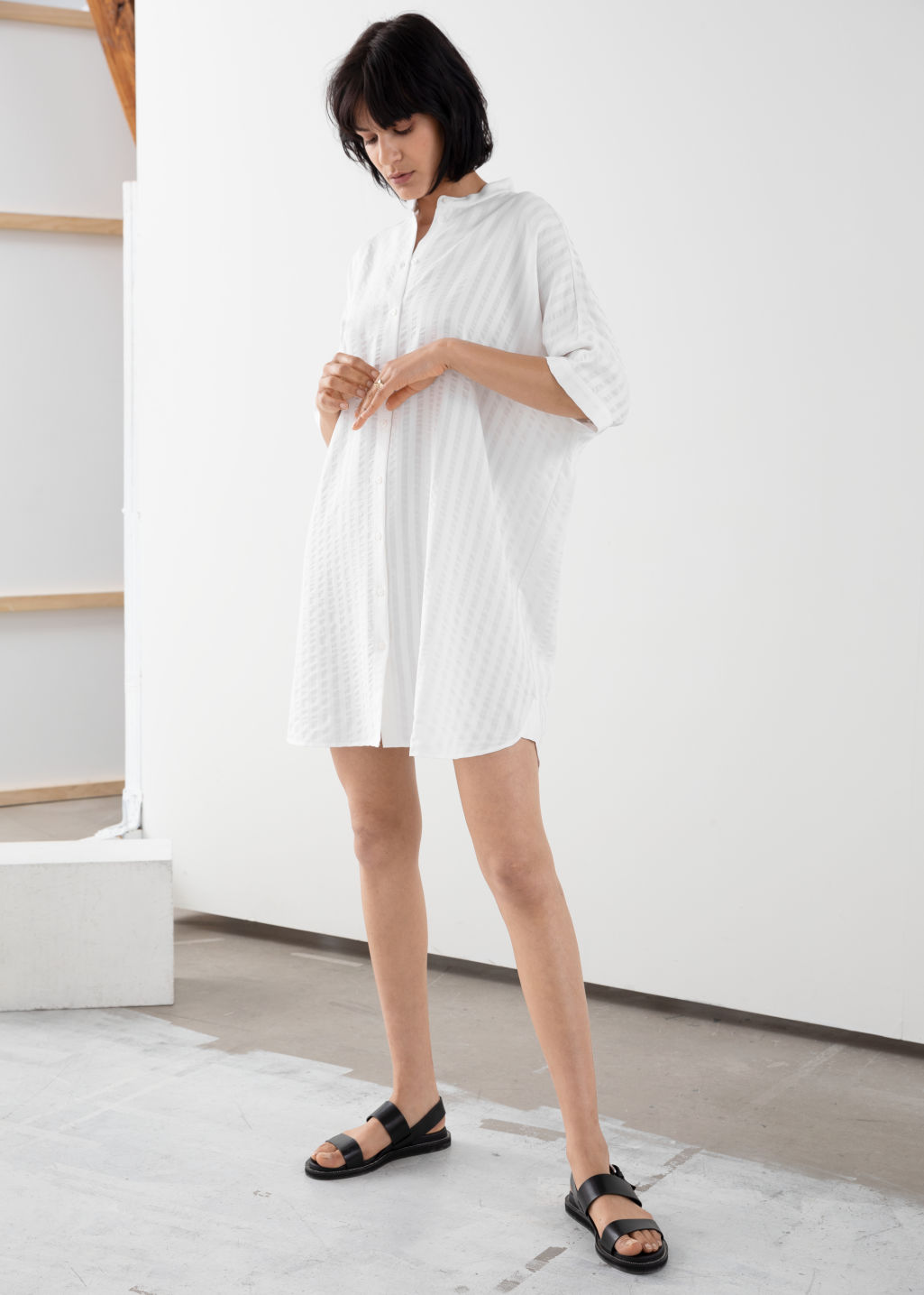 Model front image of Stories oversized shirt dress in white