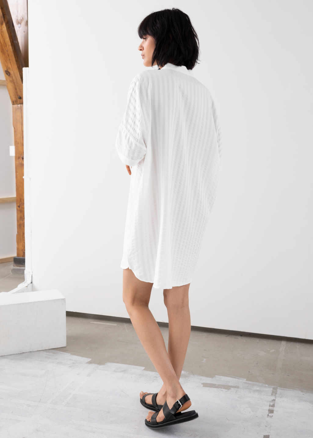 Model back image of Stories oversized shirt dress in white