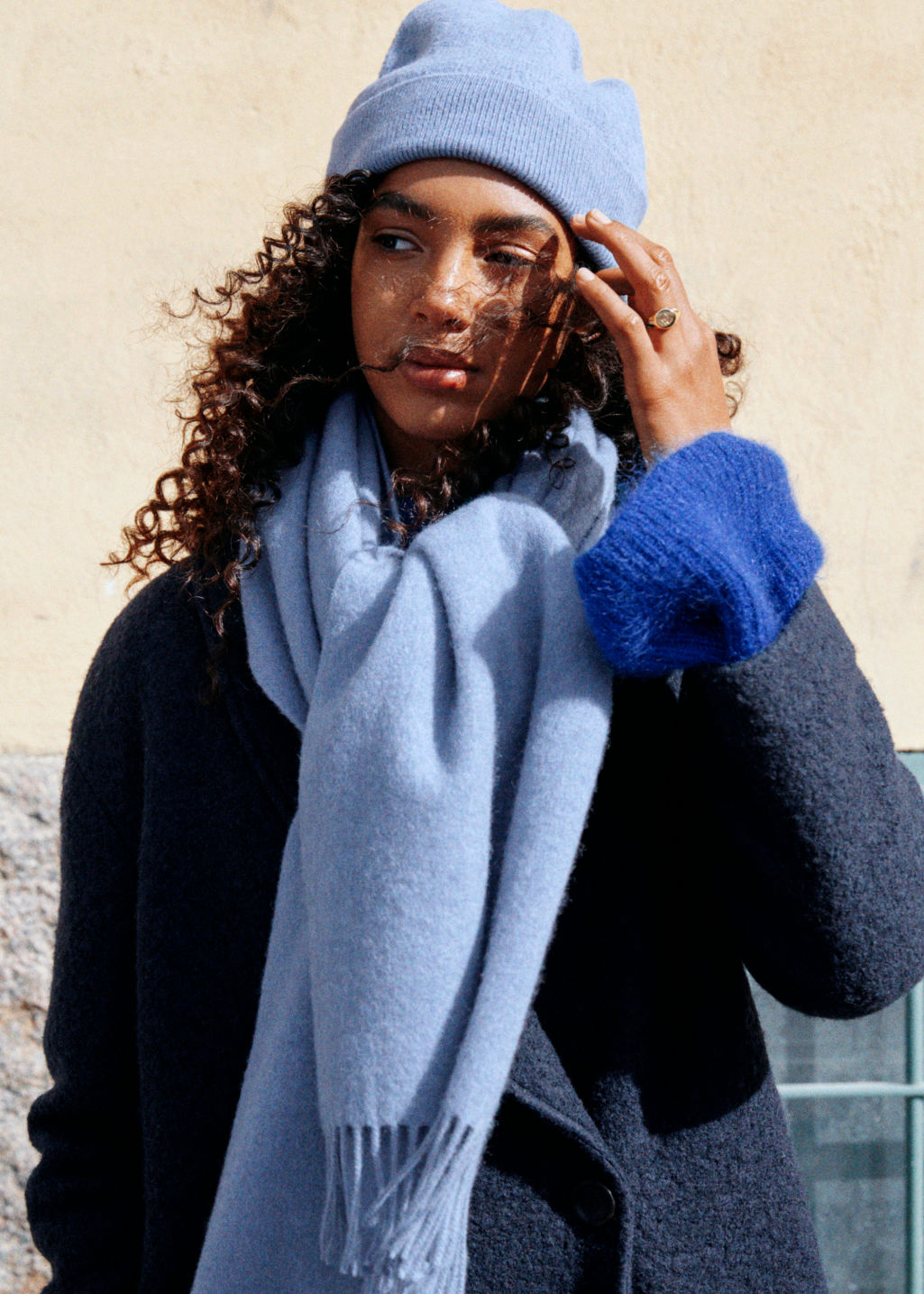 Model back image of Stories oversized wool scarf in blue