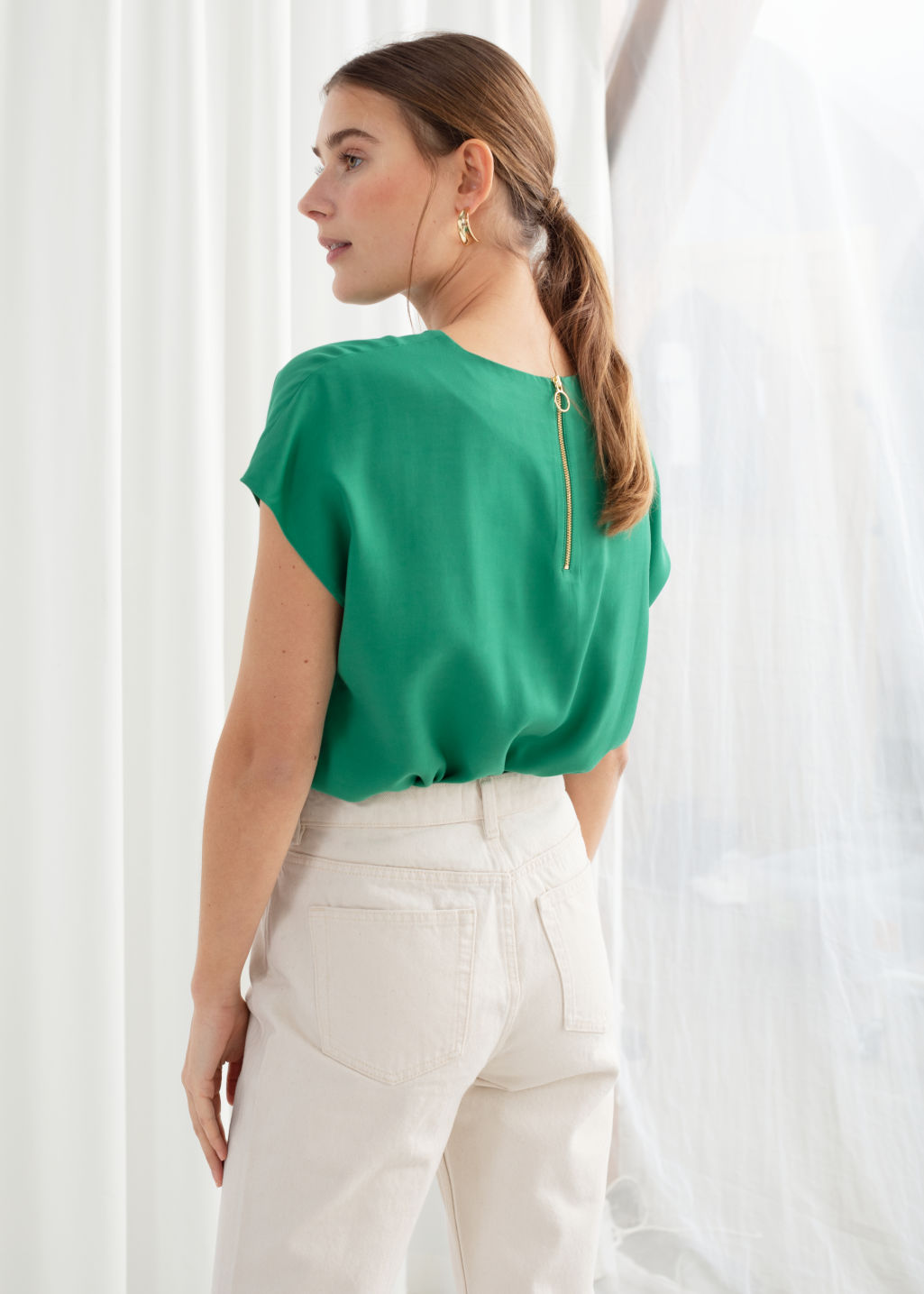 Model back image of Stories viscose top in green