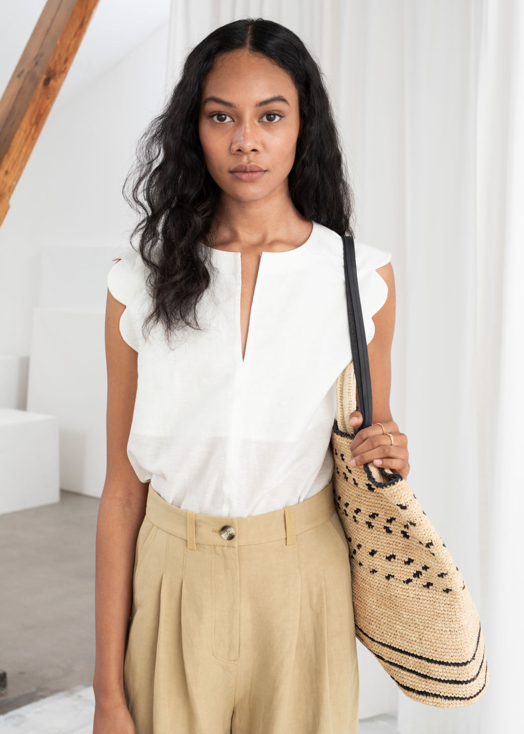 Model front image of Stories scalloped blouse in white