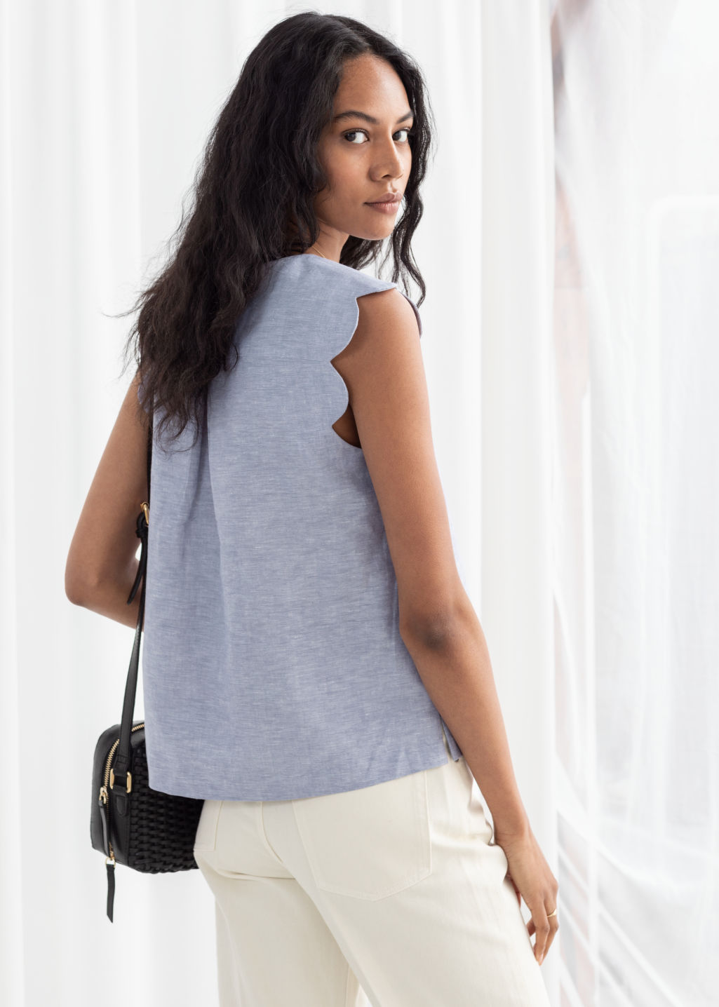 Model back image of Stories scalloped blouse in blue