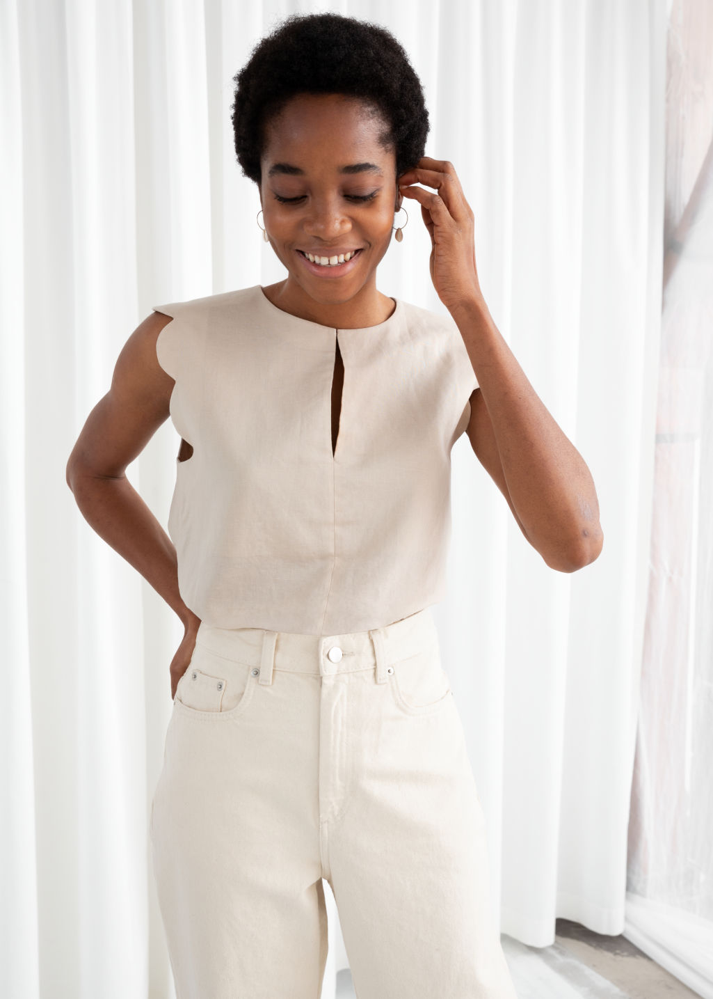 Model front image of Stories scalloped blouse in beige