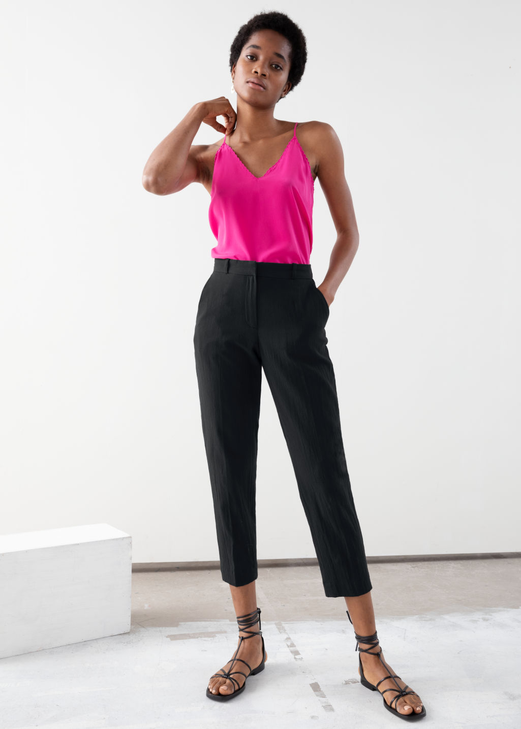 Model front image of Stories tapered cotton trousers in black