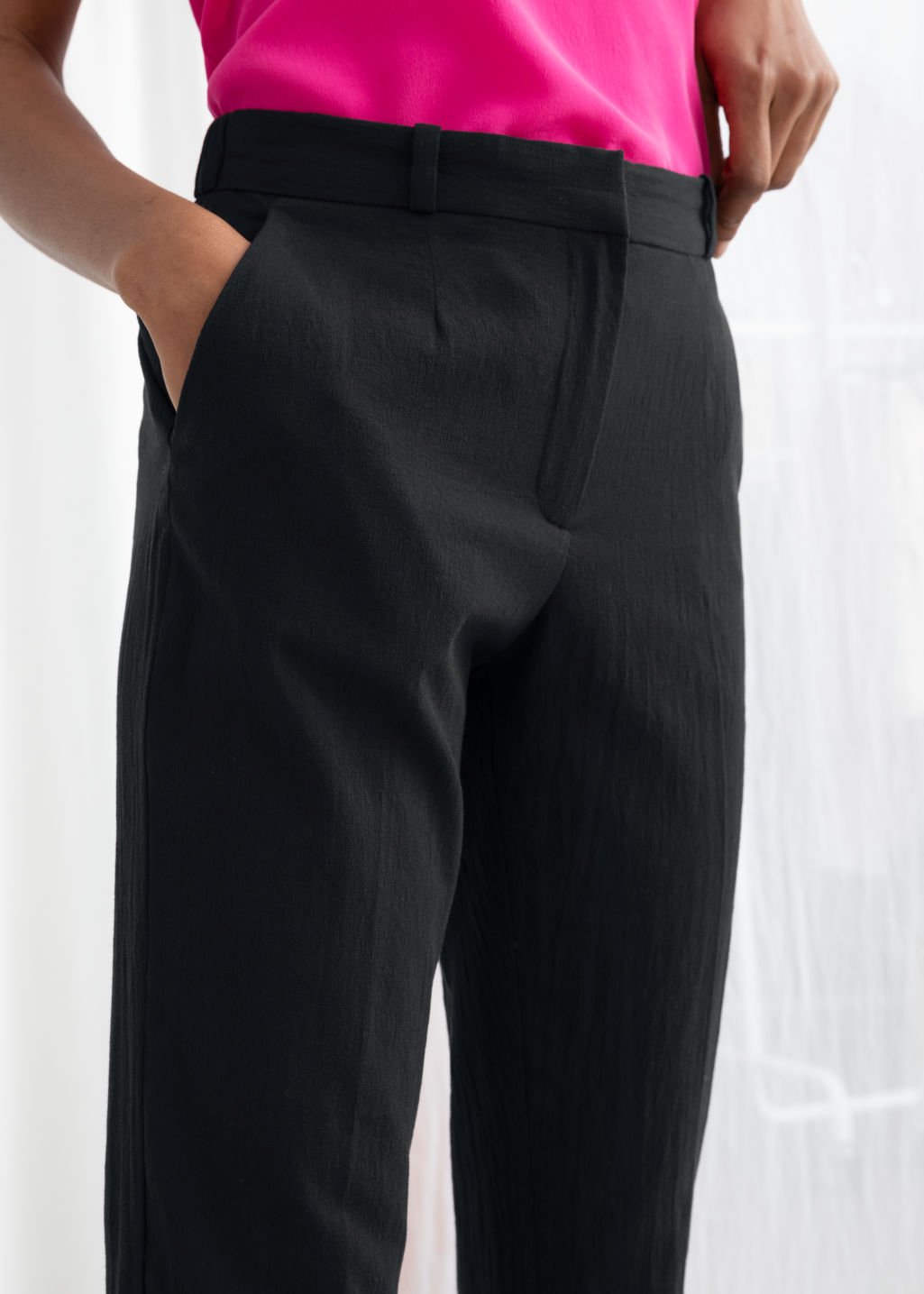 Model back image of Stories tapered cotton trousers in black
