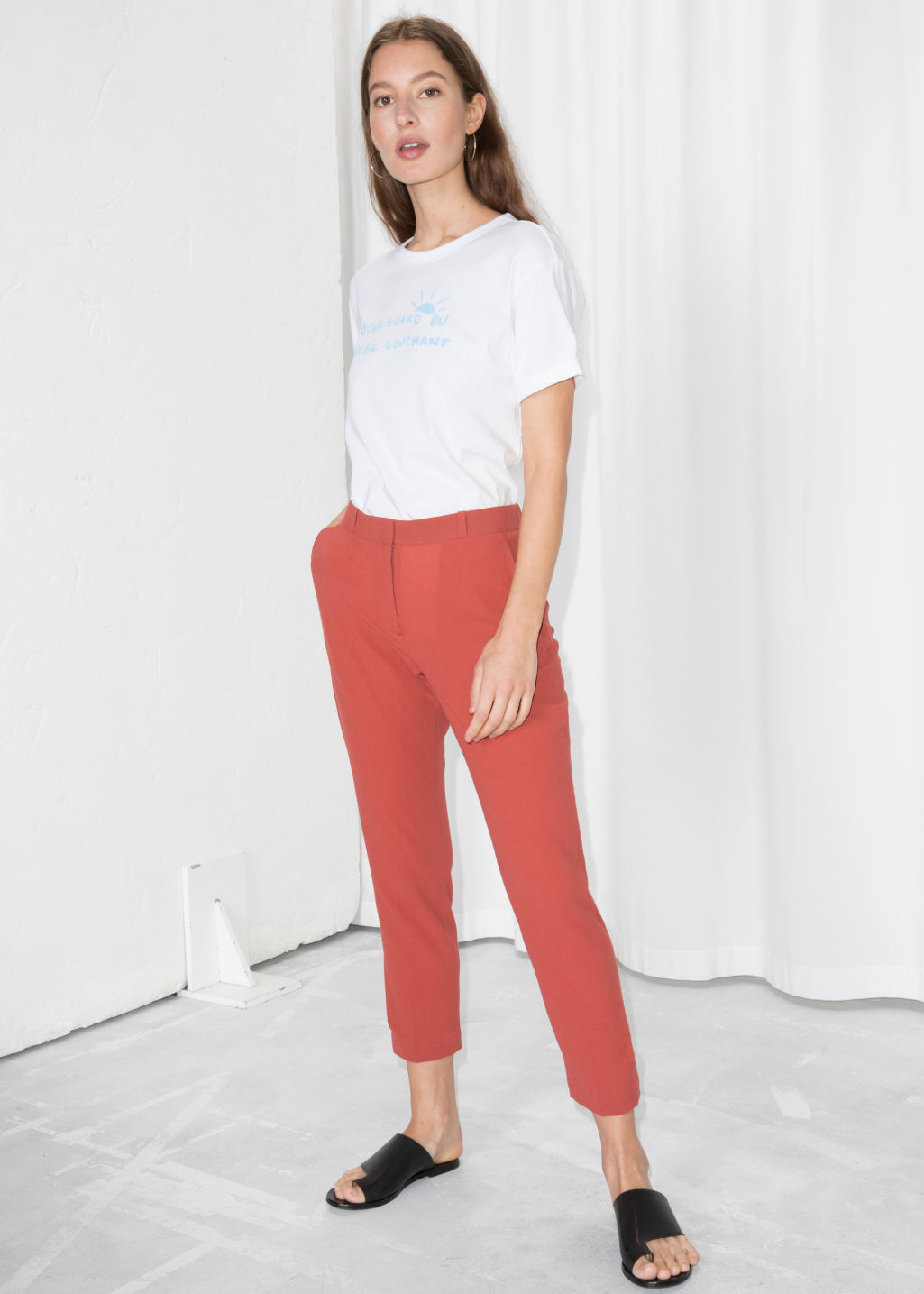 Model front image of Stories tapered cotton trousers in red