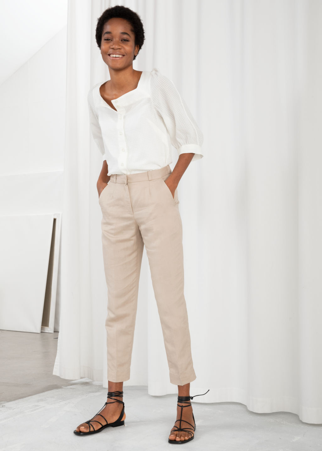 Model front image of Stories tapered cotton trousers in beige