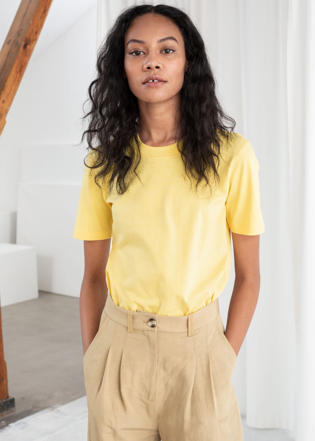 Model front image of Stories cotton t-shirt in yellow