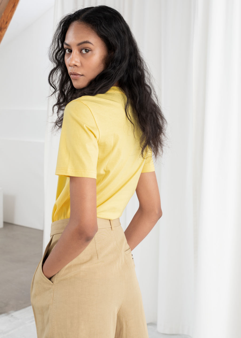 Model back image of Stories cotton t-shirt in yellow
