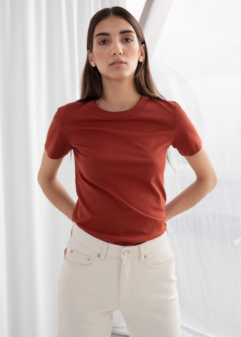Model front image of Stories cotton t-shirt in red