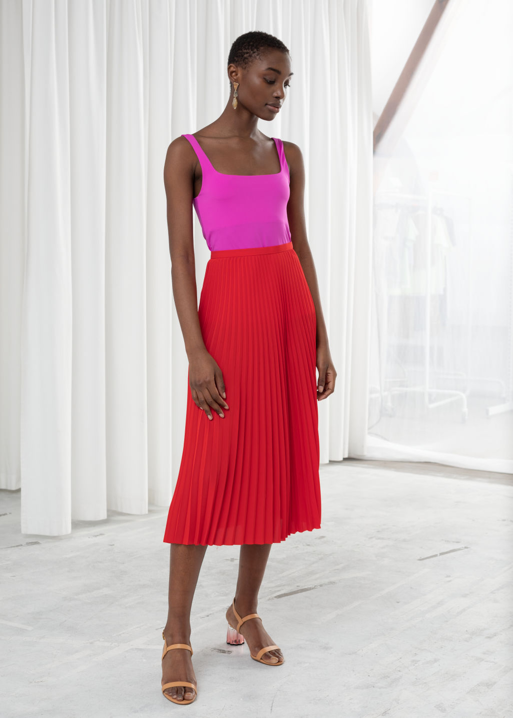 Model front image of Stories pleated midi skirt in red