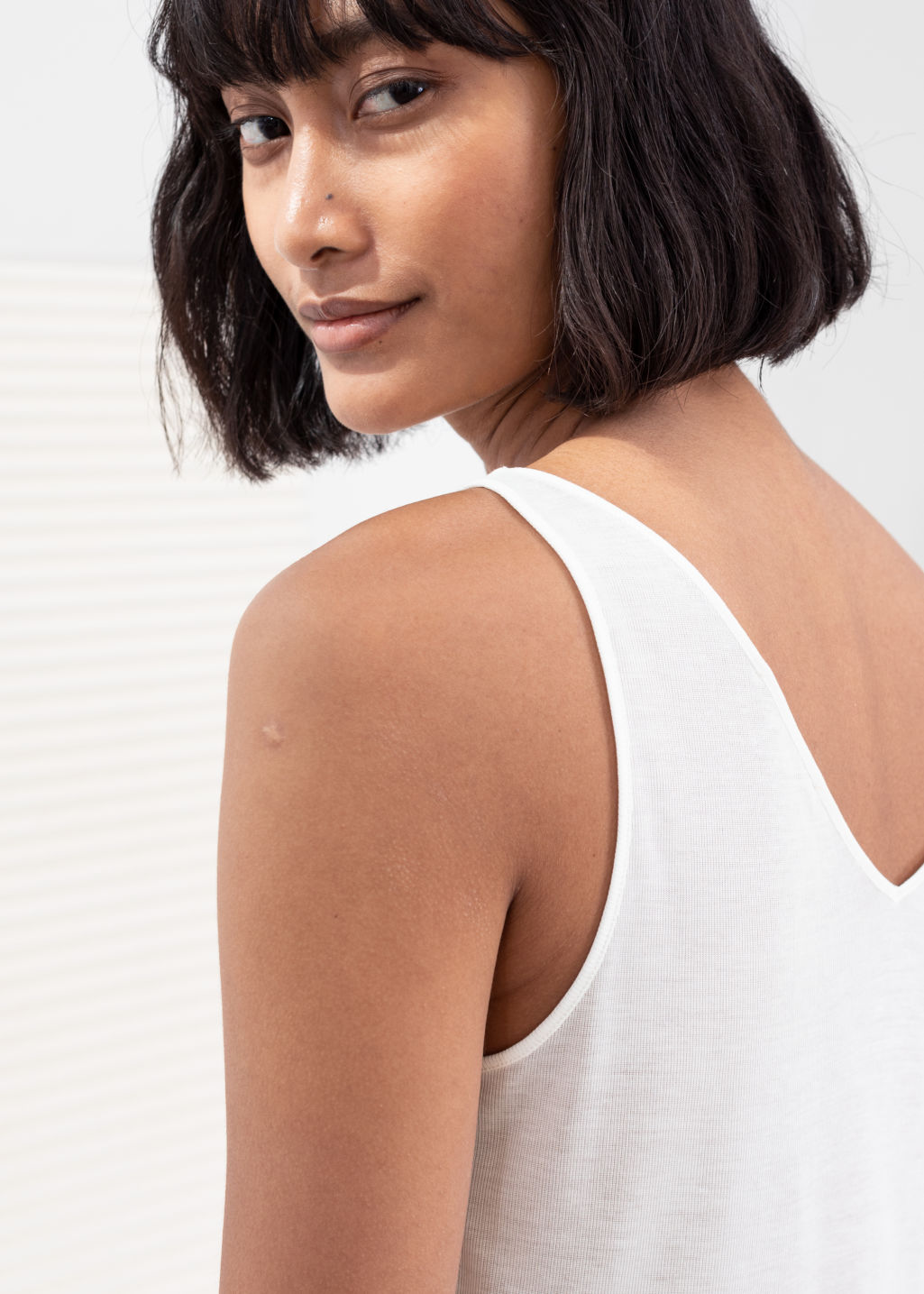 Model back image of Stories ribbed v-neck top in white