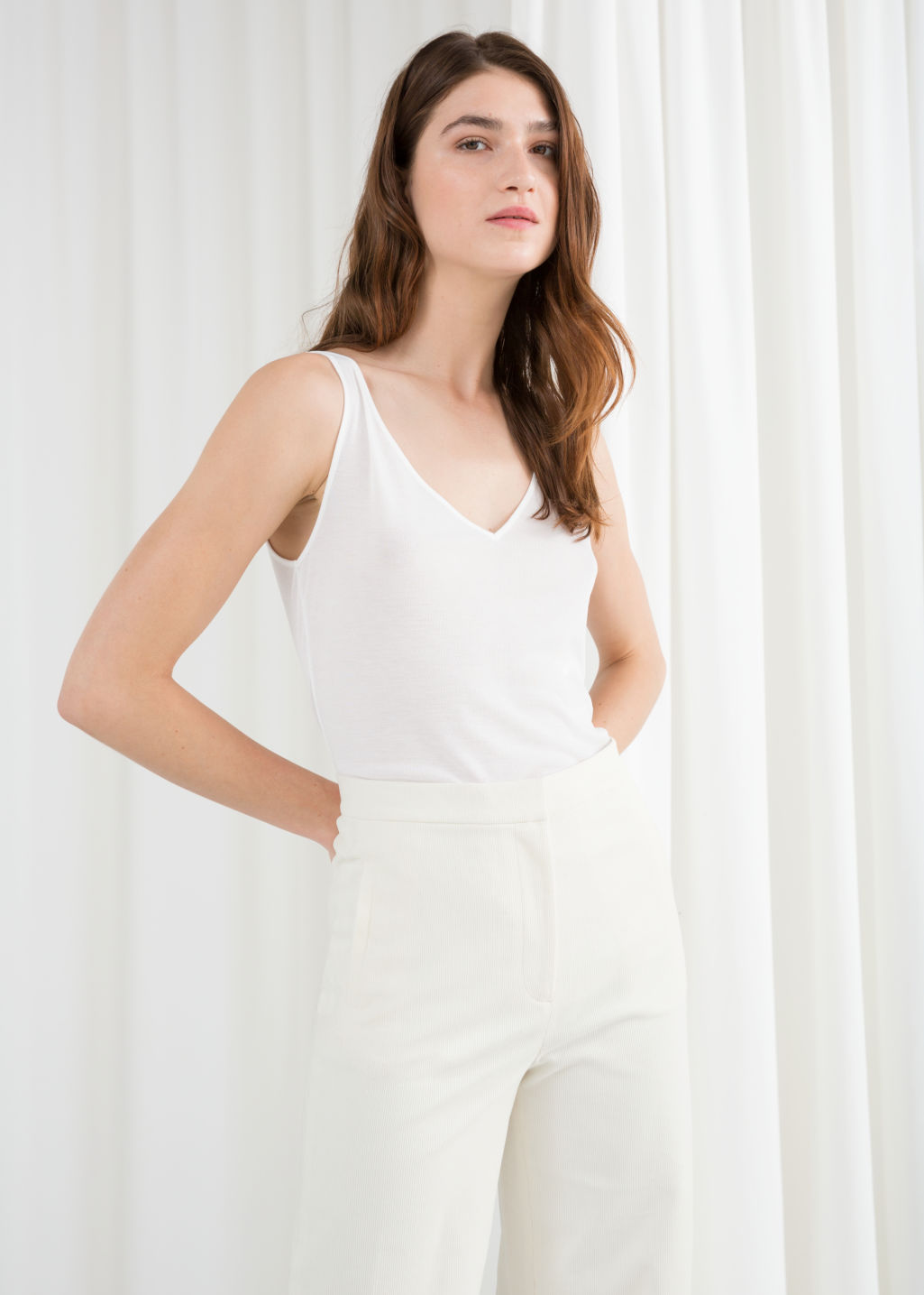 Model front image of Stories ribbed v-neck top in white