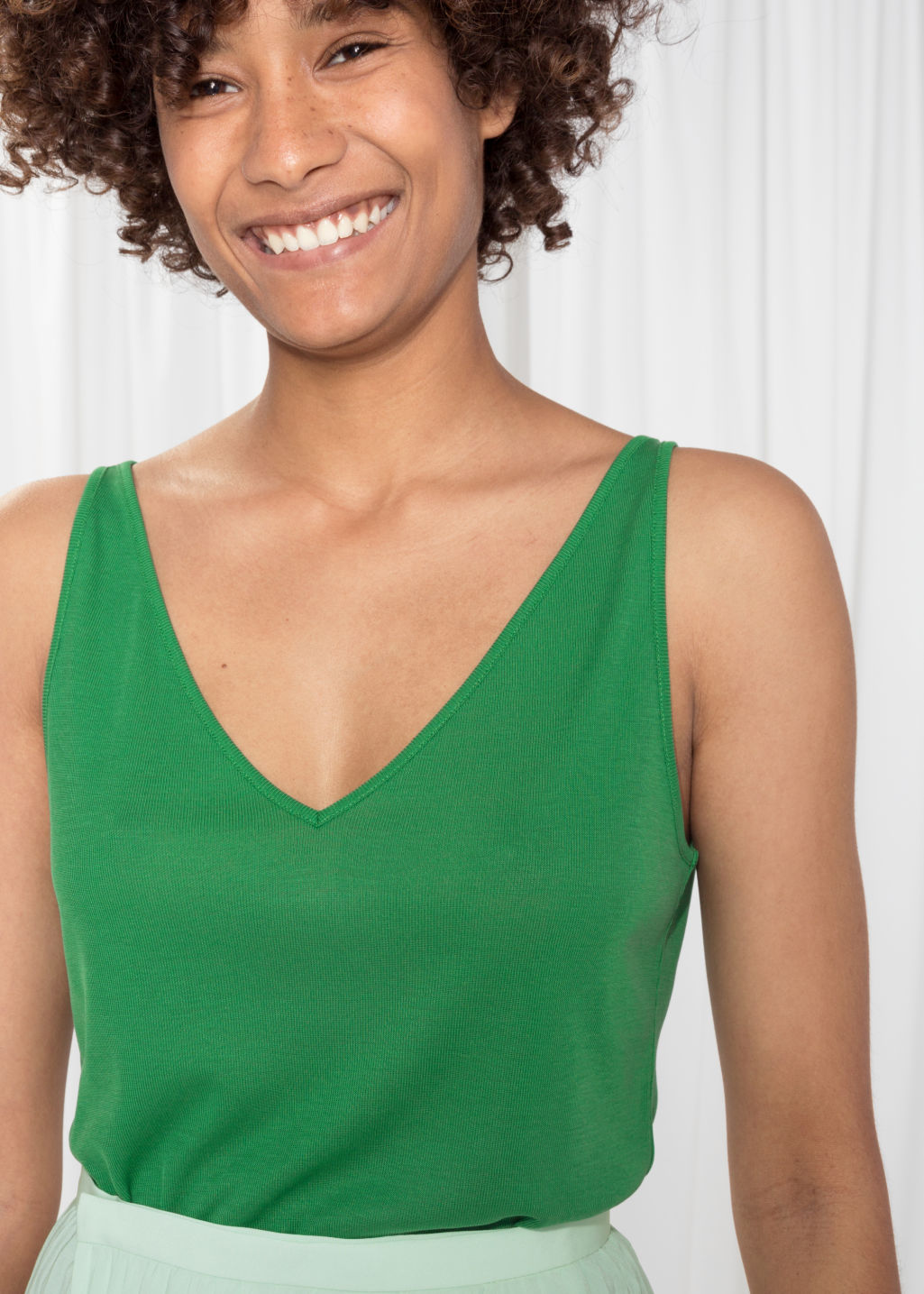 Model back image of Stories ribbed v-neck top in green
