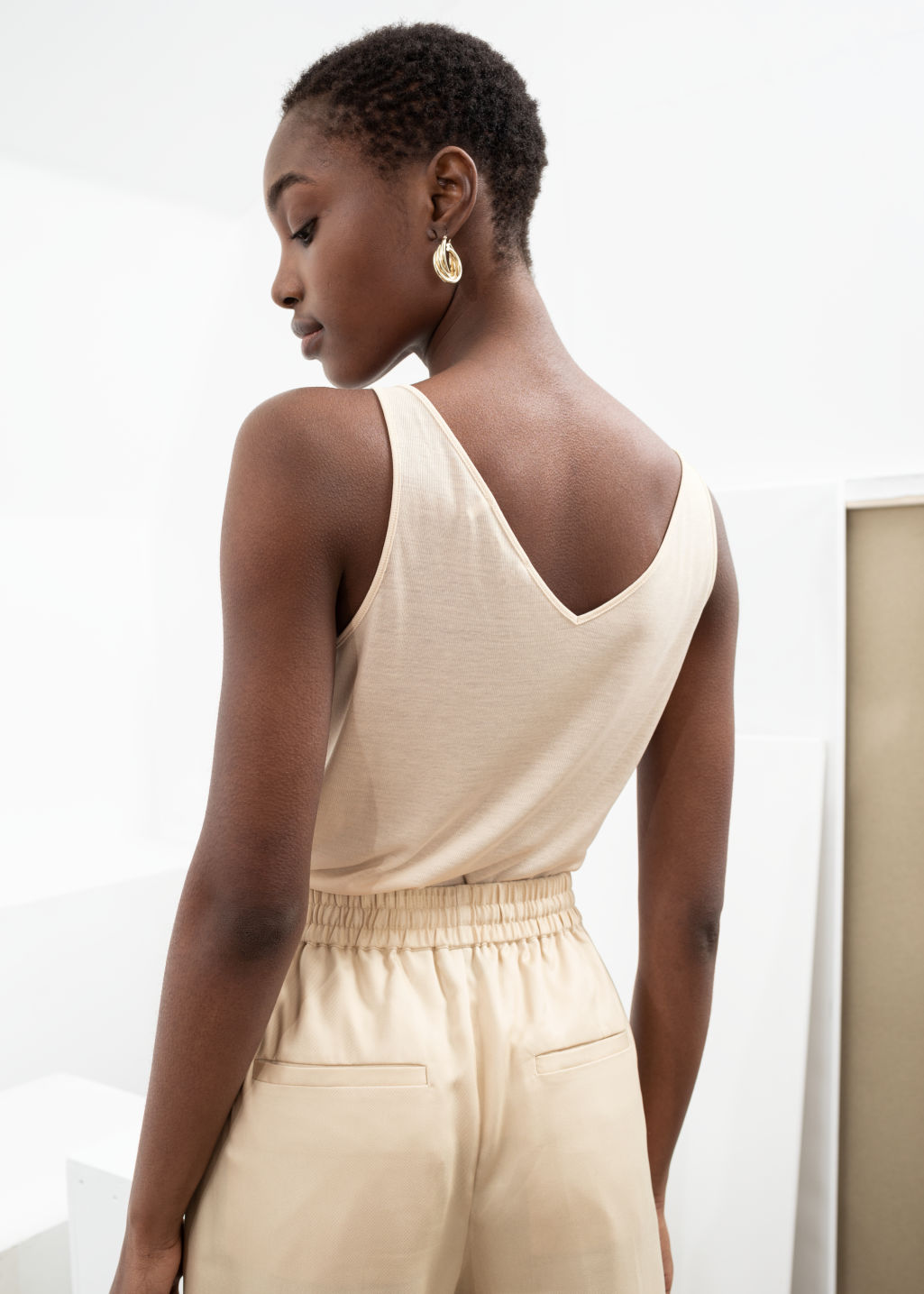 Model back image of Stories ribbed v-neck top in beige