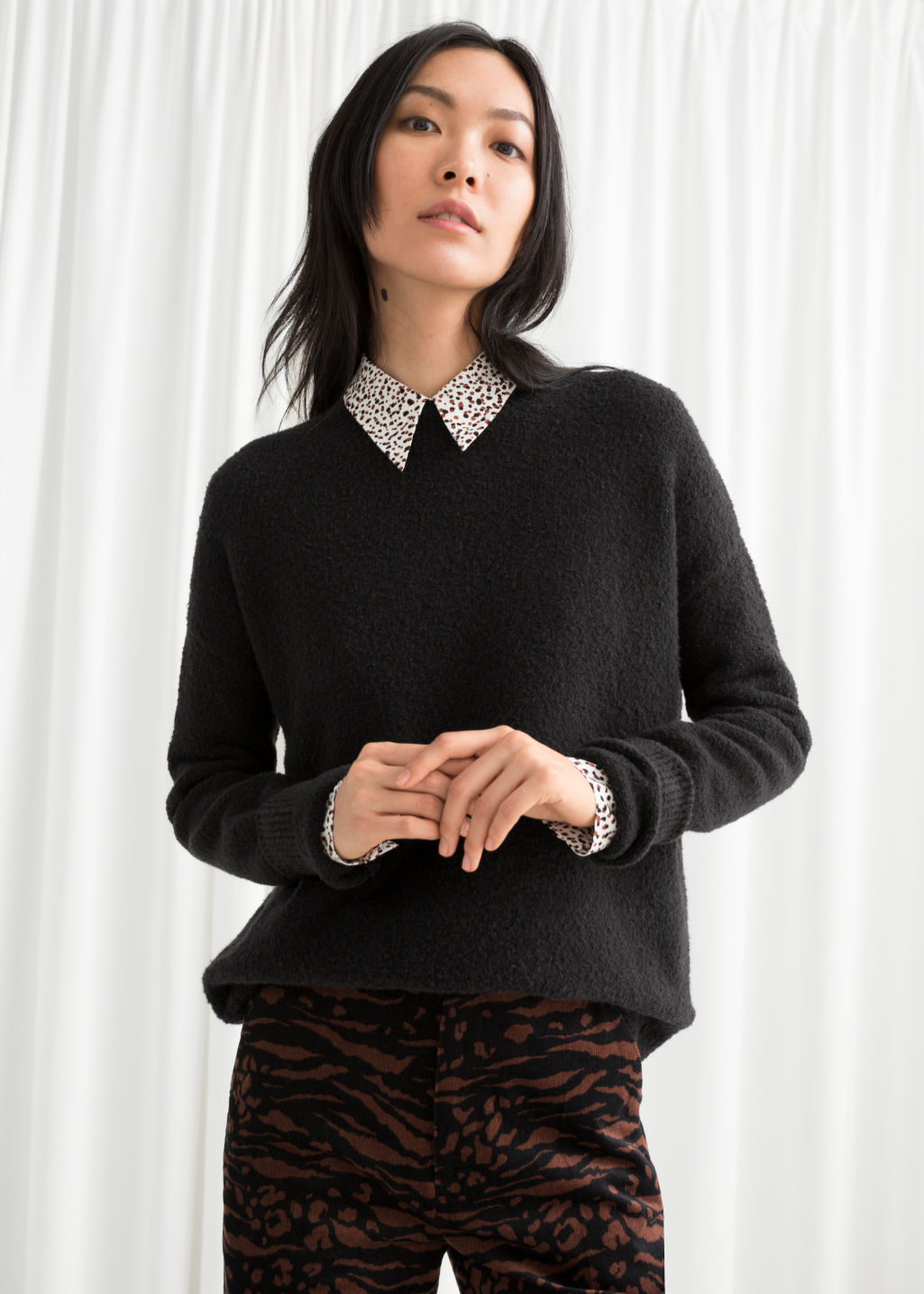 Model front image of Stories knit sweater in black