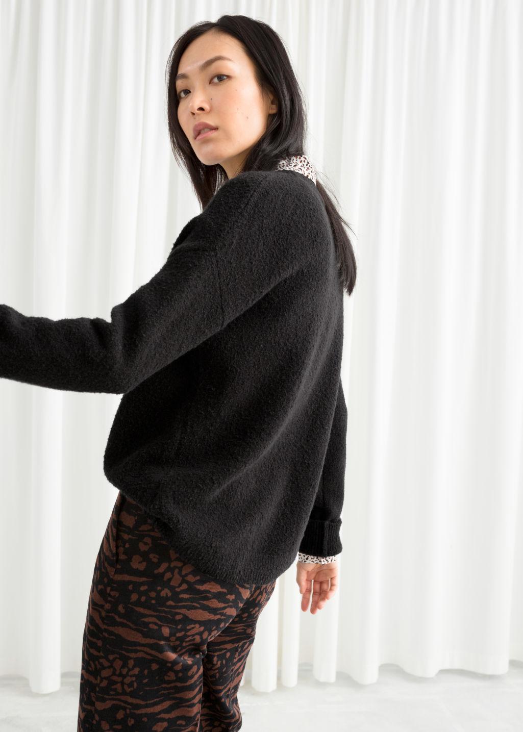 Model back image of Stories knit sweater in black