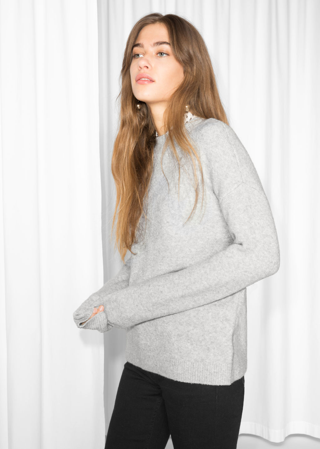 Model front image of Stories knit sweater in grey