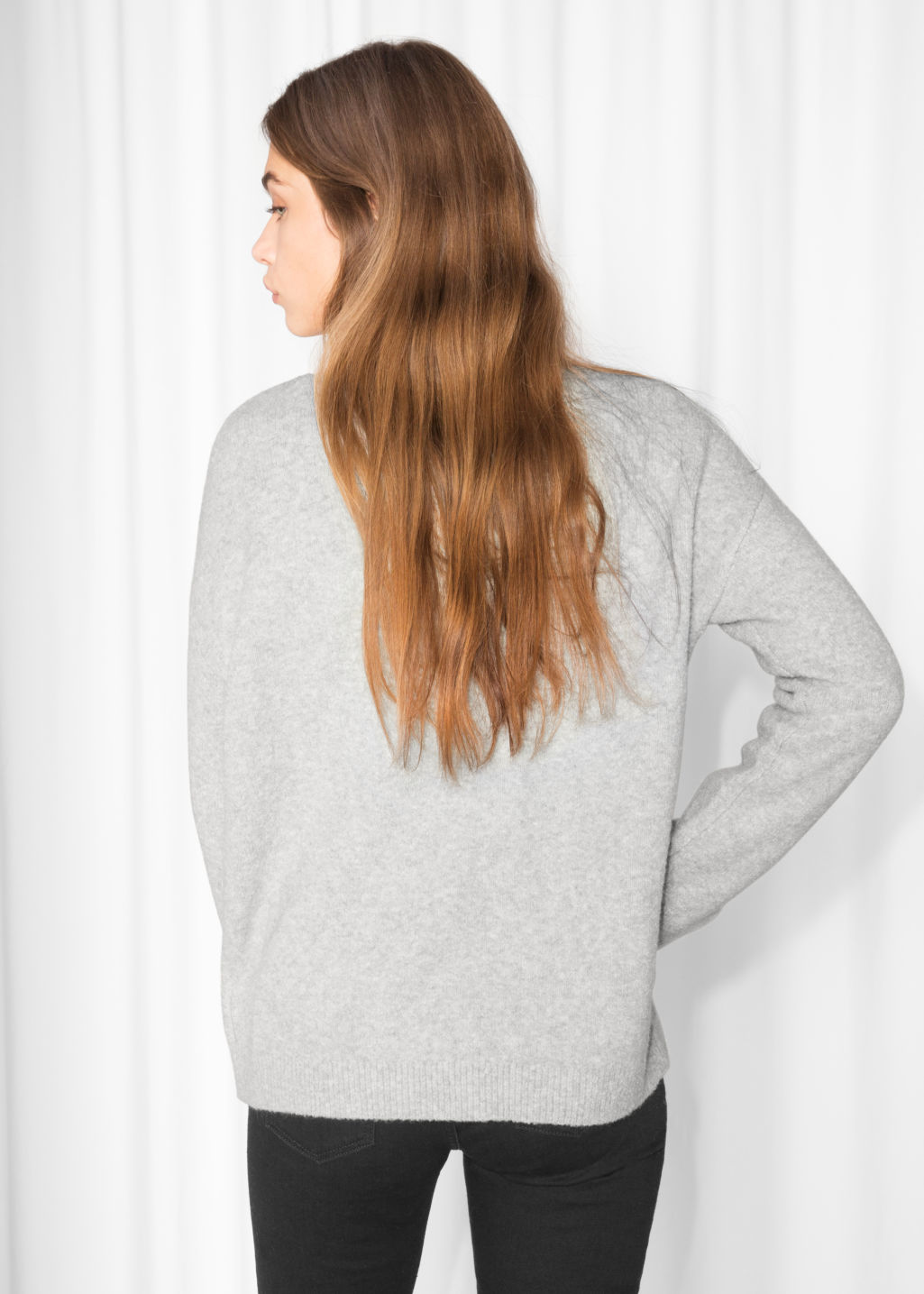 Model back image of Stories knit sweater in grey