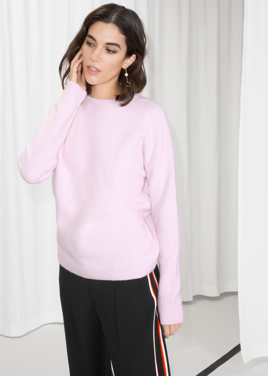 Model front image of Stories knit sweater in pink