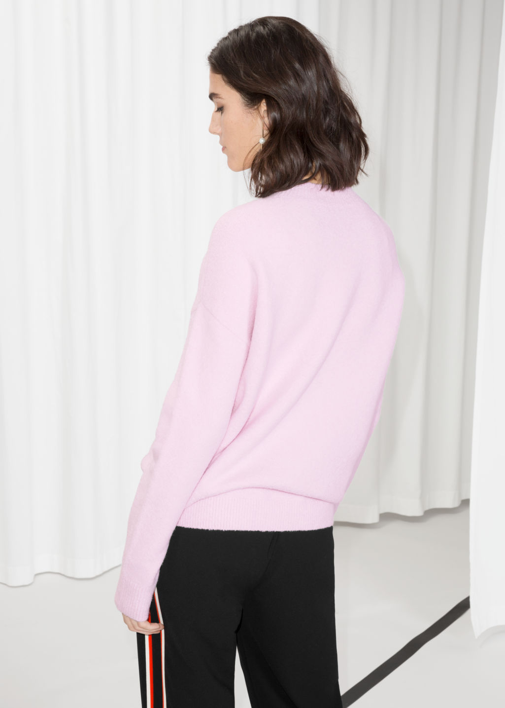 Model back image of Stories knit sweater in pink