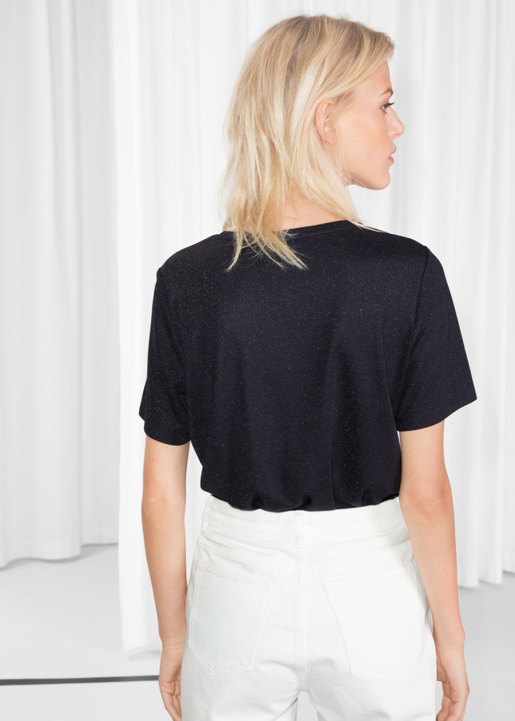 Model back image of Stories t-shirt in blue